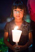 "Sept. 19 - PHOENIX, AZ: Children with candles support the DREAM Act in front of Sen. John McCain's office in Phoenix Sunday night. About 30 people met in front of US Sen. John McCain's office in Phoenix Sunday night to demonstrate in support of the DREAM Act, which is scheduled to be debated in the US Senate on Tuesday, Sept 21. The Development, Relief and Education for Alien Minors Act (The ""DREAM Act"") is a piece of proposed federal legislation in the United States that was introduced in the United States Senate, and the United States House of Representatives on March 26, 2009. This bill would provide certain illegal immigrant students who graduate from US high schools, who are of good moral character, arrived in the U.S. as minors, and have been in the country continuously for at least five years prior to the bill's enactment, the opportunity to earn conditional permanent residency. In the early part of this decade McCain supported legislation similar to the DREAM Act, but his position on immigration has hardened in the last two years and he no longer supports it. The protesters, mostly area students, marched and drilled to show their support for the US military and then held a candle light vigil.   Photo by Jack Kurtz"