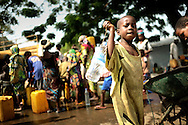 """Woman and children getting water at the fragile PK12 area, where an enclave of muslim refugees have been trying to leave for weeks, but without transport.<br /> -- Sadly there is nothing new about the atrocities being inflicted against civilians in the Central African Republic. What is new is the scale of the violence and widespread and arbitrary targeting of people solely because of their religion.<br /> Christian militia loyal to former President Francois Bozize began an offensive last week against the capital, Bangui. The militia attacked mosques, daubing walls with the slogan """"Tuer les musulmans"""" (Kill the Muslims) in what Amnesty International describes as """"a shocking escalation of anti-Muslim rhetoric within the Christian community.""""<br /> In turn, largely Muslim militia known as the Seleka have killed Christians in their homes and attacked hospitals and churches. Tens of thousands of Christians have taken refuge in churches and Roman Catholic missions around the country. Some are taking shelter in hangars at the Bangui airport. One missionary in Bangui told a Roman Catholic charity: """"We have never seen anything as bad as this before. We're at the mercy of God, please pray for us.""""<br /> French troops are trying to disarm rival groups of vigilantes before a Rwanda-style genocide can take hold. But the Central African Republic is the size of France, and there are fewer than 2,000 of these troops currently deployed -- along with some 2,500 African peacekeepers. The French intervention has reduced the violence in Bangui, but the long-term danger is that sectarian brutality will perpetuate communal hatred."""