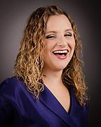 Headshot of a female opera singer actress.