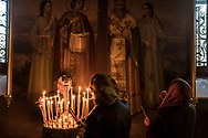 Women light candles during the Brethren service at the Church of the Exaltation of the Cross at the Kyiv-Pechersk Lavra on Saturday, October 6, 2018 in Kyiv, Ukraine.