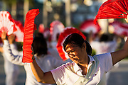 29 JUNE 2013 - PHNOM PENH, CAMBODIA: People stretch and do Tai Chi exercises in the early morning hours on Sisowath Quay in Phnom Penh.       PHOTO BY JACK KURTZ