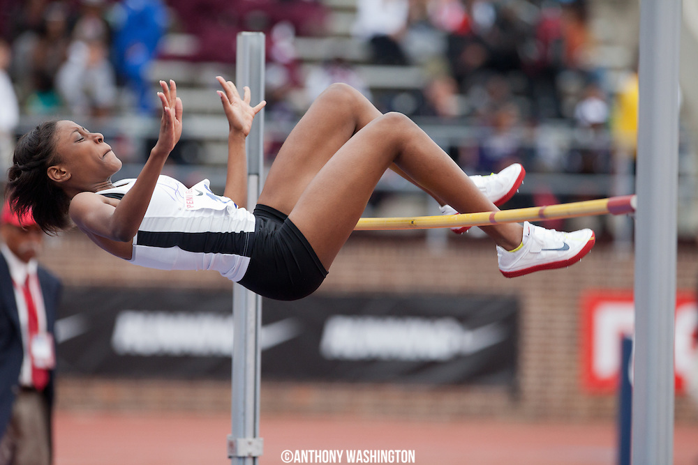 Annastacia Forrester of Manchester School in Jamaica attempts to clear  the bar during the High School Girls High Jump Championship at the <br />