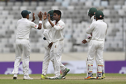 August 28, 2017 - Mirpur, Bangladesh - Bangladesh's Mehedi Hasan Miraz, second right, celebrate with his teammates after the dismissal of Australian cricket captain Steve Smith during day two of the First Test match between Bangladesh and Australia at Shere Bangla National Stadium on August 28, 2017 in Mirpur, Bangladesh. (Credit Image: © Ahmed Salahuddin/NurPhoto via ZUMA Press)