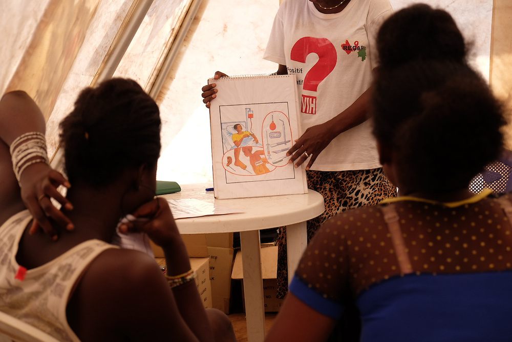 Women participate in an awareness session on HIV transmission at the MSF mobile clinic in the neighbourhood of Sangoyah Market, Conakry, Guinea on March 17, 2016. MSF launched a HIV testing campaign in Conakry with the support of health authorities moving throughout several neighbourhoods throughout 2016.<br /> <br /> Despite countries in West and Central Africa having a relatively low HIV prevalence (