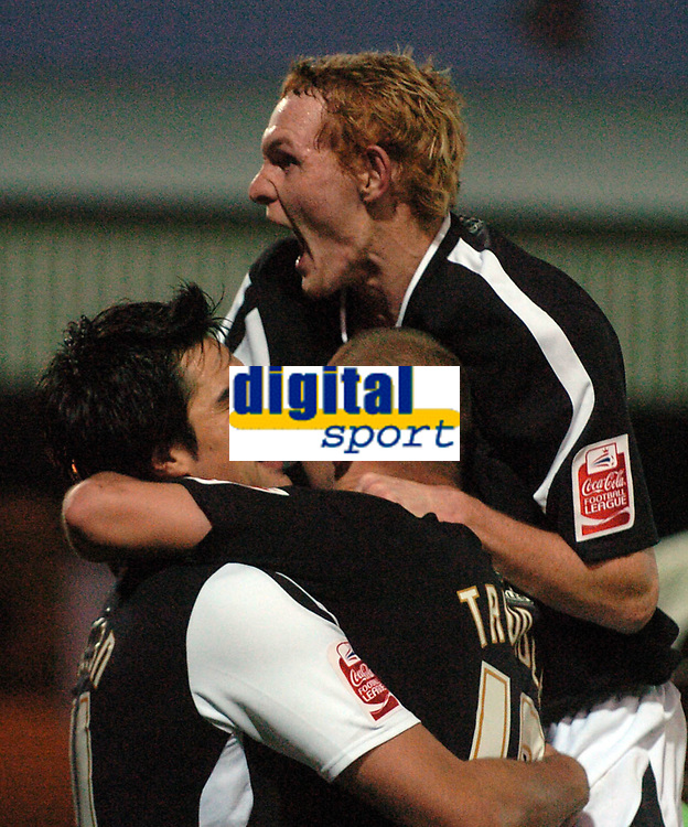 Photo: Paul Greenwood.<br />Port Vale v Swansea City. Coca Cola League 1. 18/11/2006. Shaun Macdonald, centre, celebrates victory with Rory Fallon and Lee Trundle.