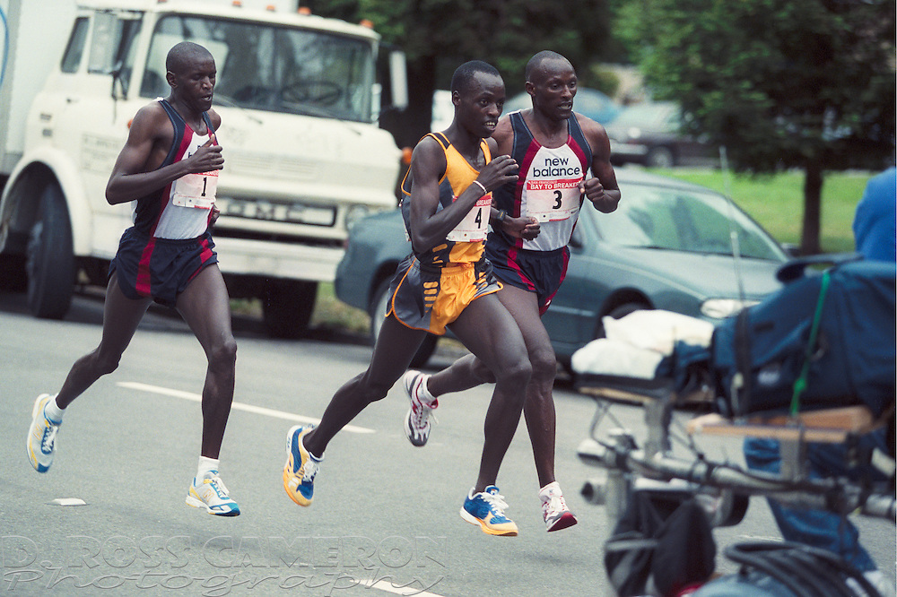 James Koskei (1), from left, Simson Limareng (4) and Tom Nyariki (3) battle for the lead at the 91st running of the Bay to Breakers 12K race, Sunday, May 19, 2002 in San Francisco. Koskei won for the second year in a row, with a time of 34:03. (Photo by D. Ross Cameron)