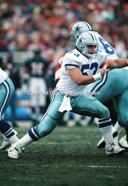 Dallas Cowboys center Mark Stepnoski (53) blocks during the NFL NFC Wild Card playoff football game against the Chicago Bears on Dec. 29, 1991 in Chicago. The Cowboys won the game 17-13. (©Paul Anthony Spinelli)