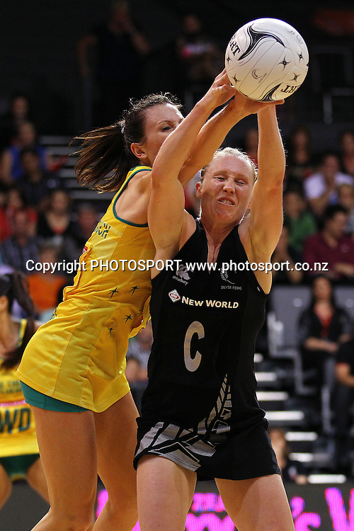 Silver Fern's Laura Langman competes against Australia's Natalie von Bertouch. New World Quad Series, New Zealand Silver Ferns v Australian Diamonds at Claudelands Arena, Hamilton, New Zealand. Thursday 1st November 2012. Photo: Anthony Au-Yeung / photosport.co.nz