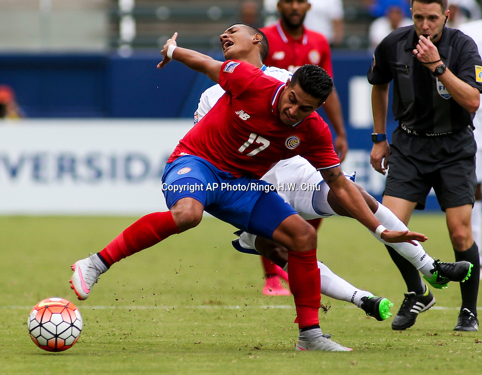 Costa Rica forward Ronald Matarrita #17, front, fights for the ball with Honduras midfielder Bryan Josue Acosta Ramos #6 in the first half of a CONCACAF men's Olympic qualifying soccer match in Carson, Calif., Sunday, Oct. 4, 2015. (AP Photo/Ringo H.W. Chiu)