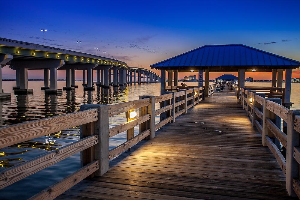Ocean Springs bridge with pier at sunset