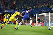 Loïc Rémy takes on Omri Ben Harush during the Champions League match between Chelsea and Maccabi Tel Aviv at Stamford Bridge, London, England on 16 September 2015. Photo by Andy Walter.