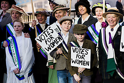 "© Licensed to London News Pictures. 08/03/2015. London, UK. Demonstrators dressed as suffragettes at the ""Walk In Her Shoes"" event to mark International Women's Day at The Scoop amphitheatre on the south bank in London. Photo credit : Vickie Flores/LNP"