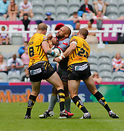 Craig Kopczak (L) and Lee Mossop (R) of Salford Red Devils tackle Sam Moa (C) of Catalans Dragons during the Betfred Super League match at the Dacia Magic Weekend, St. James's Park, Newcastle<br /> Picture by Stephen Gaunt/Focus Images Ltd +447904 833202<br /> 20/05/2018
