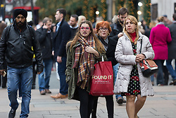 © Licensed to London News Pictures. 21/12/2016. London, UK. People Christmas shopping in Oxford street in London, during the last week before Christmas. Photo credit : Vickie Flores/LNP