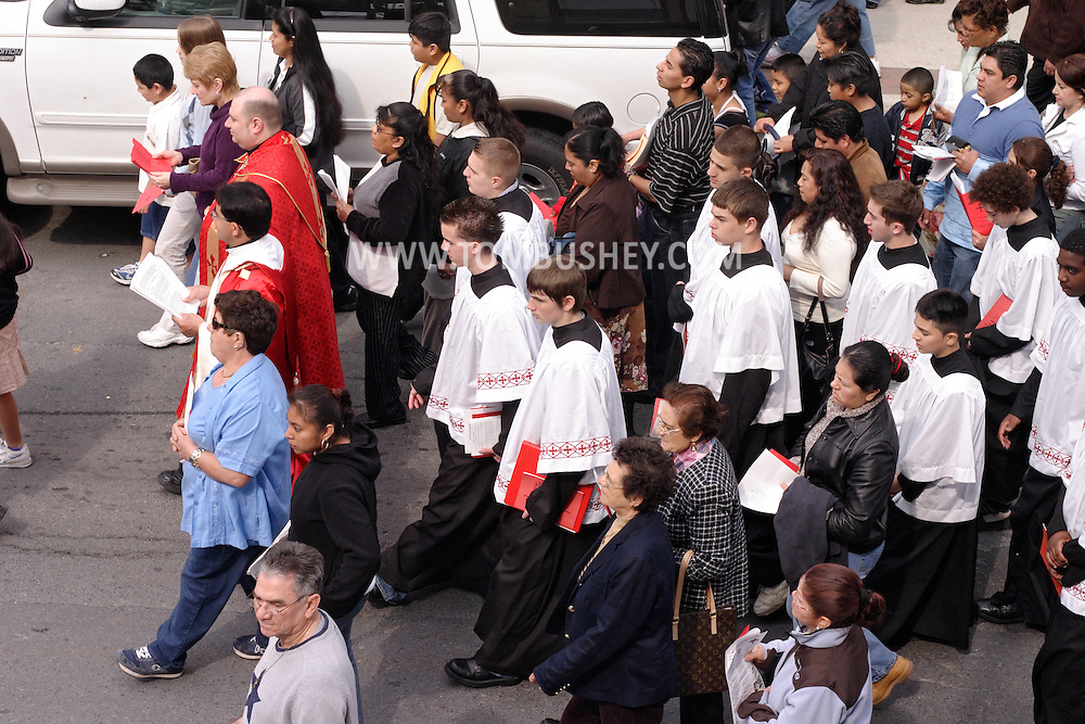 Middletown, N.Y. - Priests and parishioners from St. Joseph's Church walk down North Street during a Stations of the Cross procession on Good Friday. April 14, 2006. ©Tom Bushey/The Image Works