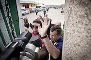 Palazzo San Gervasio (PZ) 14.06.2011 - Centro di Identificazione ed Espulsione. Una delegazione di parlamentari composta dai deputati Jean Leonard Touadi (Pd), Rosa Villecco Calipari (Pd) e Giuseppe Giulietti (Gruppo misto) - che oggi e' entrata nel Centro di identificazione ed espulsione (Cie) di Palazzo San Gervasio - ne ha chiesto ''l'immediata chiusura, per via delle inaccettabili condizioni di detenzione in cui versano 57 giovani tunisini''. Nella Foto: La polizia impedisce le riprese dell'interno del Cie..Foto Giovanni Marino