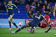 Kenneth Omeruo of Middlesbrough &copy; slides in to deny Kenwyne Jones of Cardiff city. Skybet football league championship match, Cardiff city v Middlesbrough at the Cardiff city stadium in Cardiff, South Wales on Tuesday 16th Sept 2014<br /> pic by Andrew Orchard, Andrew Orchard sports photography.