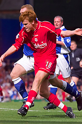 LIVERPOOL, ENGLAND - Saturday, September 15, 2001: Liverpool's John Arne Riise gets past Everton's Mark Pembridge on his way to scoring the third goal during the Premiership match at Goodison Park. (Pic by David Rawcliffe/Propaganda)