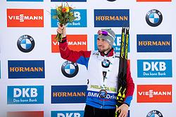 Third placed Alexander Loginov (RUS) during flower ceremony after the Pursuit Men 12,5 km at day 8 of IBU Biathlon World Cup 2018/19 Pokljuka, on December 9, 2018 in Rudno polje, Pokljuka, Pokljuka, Slovenia. Photo by Urban Urbanc / Sportida