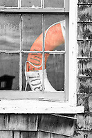 Picture of a old window and lifesaver at Chicamacomico Lifesaving Satiation on Hatteras Island.