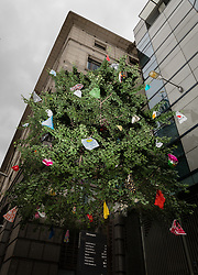 © Licensed to London News Pictures. 24/06/2017. LONDON, UK. Martin Creed's Work No. 2814, 'Plastic bags' is displayed on Bishopsgate in the City of London as part of Sculpture in the City. Playing with the idea of the plastic bags being tree blossom the work suggests irony with this synthetic medium. Plastic bags often get caught in tree branches, Martin has repeated this poetic combination almost to excess with many bags from his personal 'collection'. Sulpture in the City is the City of London's annual free public art programme set amongst iconic architectural landmarks.  Photo credit: Vickie Flores/LNP