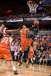 Virginia guard Calvin Baker (4) leaps for a shot against Duke.  The Virginia Cavaliers men's basketball team fell to the #6 Duke Blue Devils 86-70 at the University of Virginia's John Paul Jones Arena in Charlottesville, VA on March 5, 2008.