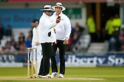 Umpires Aleem Dar and Rod Tucker call proceedings off for bad light during day 2 of the first Investec Test Series 2016 match between England and Sri Lanka at Headingley Stadium, Headingley, United Kingdom on 20 May 2016. Photo by Simon Davies.