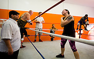 Championship Wrestling Entertainment co-founder and owner Chris Quinones (left) coaches Mandy Kantor, of Lakewood Park, during wrestling class Wednesday, April 22, 2015, at CWE's gym at 1035 SW Biltmore St. in Port St. Lucie. (XAVIER MASCAREÑAS/TREASURE COAST NEWSPAPERS)