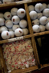 Stanford golf course store detail of golf balls and pins.