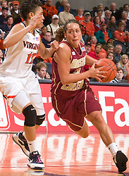 Boston Coll. guard Corey Rusin (21) is defended by Virginia guard Britnee Millner (12).  The #21 ranked Virginia Cavaliers defeated the Boston College Eagles 90-70 at the John Paul Jones Arena in Charlottesville, VA on February 22, 2009.