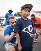 Los Angeles Rams coach Sean McVay signs an autograph during community improvement project at Belvedere Elementary School to upgrade play and social spaces around the school by building a new playground structure, painting murals and basketball backboards and landscaping., Friday, June 14, 2019, in Los Angeles, Calif. (Ed Ruvalcaba/Image of Sport)