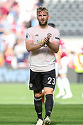 Manchester United Defender Luke Shaw applauds the fans at the end during the Premier League match between West Ham United and Manchester United at the London Stadium, London, England on 29 September 2018.