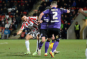 Kevin Stewart during the Sky Bet League 2 match between Cheltenham Town and Morecambe at Whaddon Road, Cheltenham, England on 16 January 2015. Photo by Alan Franklin.