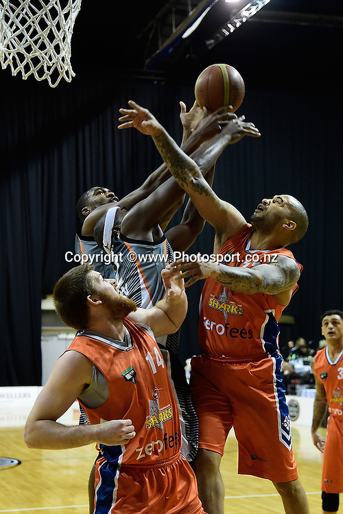 Brian Conklin (Bottom L) and Kevin Braswell (R of the Sharks jump for the ball with Kareem Johnson (C and Dustin Scott (Back) of the Hawks during a NBL - Hawks vs Sharks semi final four basketball match at the TSB Arena in Wellington on Friday the 4th of July 2014. Photo by Marty Melville/www.Photosport.co.nz