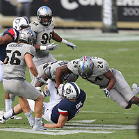 ORLANDO, FL - NOVEMBER 11: Gabriel Luyanda #24, Kyle Gibson #25  and Pat Jasinski #56 of the UCF Knights tackle Tyler Davis #9 of the Connecticut Huskies during a NCAA football game between the University of Connecticut Huskies and the UCF Knights on November 11, 2017 in Orlando, Florida. (Photo by Alex Menendez/Getty Images) *** Local Caption *** Gabriel Luyanda; Kyle Gibson; Pat Jasinski; Tyler Davis