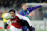 Fotball<br /> Nederland / Holland<br /> Foto: ProShots/Digitalsport<br /> NORWAY ONLY<br /> <br /> AZ - FC Groningen , 28-02-2009 , 3-0 , Graziano Pele in duel met Andreas Granqvist
