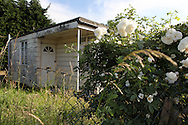 An abandoned prefab on the Excalibur Estate, September 2012. Post-war prefabricated house at the Excalibur Estate, in Catford, South London. The 186 uni-seco prefabs were built in 1946 by German and Italian prisoners of war