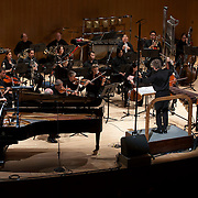 """June 8, 2012 - New York, NY : The New York Philharmonic, featuring conductor David Robertson, center right foreground, pianist Eric Huebner, far left, and percussionist Colin Currie, far right at front, perform the world premiere of Elliott Carter's 'Two Controversies and a Conversation (2010-11) during The Metropolitan Museum of Art's Presentation of """"CONTACT!,"""" the new-music series of the New York Philharmonic, on Friday night. CREDIT: Karsten Moran for The New York Times"""
