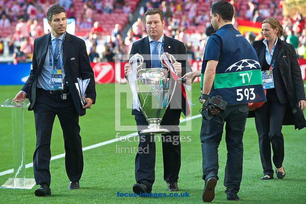 General view showing UEFA officials bringing the Champions League trophy on to the pitch pictured ahead of the UEFA Champions League Final at Est&aacute;dio da Luz, Lisbon<br /> Picture by Ian Wadkins/Focus Images Ltd +44 7877 568959<br /> 24/05/2014