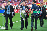 General view showing UEFA officials bringing the Champions League trophy on to the pitch pictured ahead of the UEFA Champions League Final at Estádio da Luz, Lisbon<br /> Picture by Ian Wadkins/Focus Images Ltd +44 7877 568959<br /> 24/05/2014