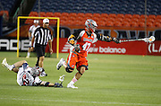DENVER, CO - JULY 4:  Craig Bunker #22 of the Boston Cannons hits the ground in pursuit of Anthony Kelly #47 of the Denver Outlaws during their MLL game at Sports Authority Field at Mile High on July 4, 2015 in Denver, Colorado. The Cannons won 22-9. (Photo by Marc Piscotty/Getty Images) *** Local Caption *** Craig Bunker, Anthony Kelly
