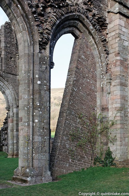 Supporting buttress preventing the collapse of the ruins at Llanthony Priory. Vale of Ewyas,Wales, 2009