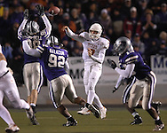 University of Texas quarterback Jevan Snead (7) throws the ball down field against pressure from Kansas State's Ian Campbell (98) and Brandon Balkcom (92) in the second half at Bill Snyder Family Stadium in Manhattan, Kansas, November 11, 2006.  The Wildcats upset 4th ranked Texas 45-42.<br />