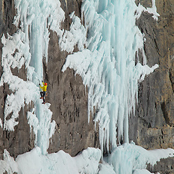 Jon Walsh climbing Whoa Whoa Capitaine, WI6 in the Tabernac Bowl, high above the Icefields Parkway.