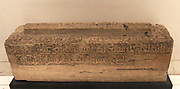 Crested grave cover found at Siraf, Iran, dated 383/993 AD.  Inscribed in elaborate kufic script around the sides: 'In the name of God the merciful the compassionate Ibrahim ibn Ali.