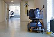 Nederland, Arnhem, 22-11-2012Scootmobiel in de gang van een verzorgingshuis.Foto: Flip Franssen