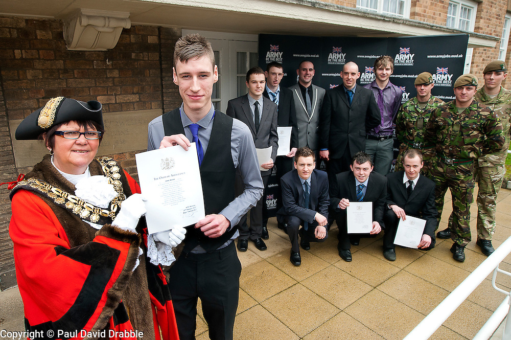 Mayor of Barnsley cllr Karen Dyson presents Oath of Allegiance certificate to Jamie Warren and (back row left to right) Dale Kirk, Rikki Cardwell, Mathew Beaumont, David Dickinson, Kane Bradbury (front Row left to right)  Ashley Brown, Daniel Crossland, Thomas Jevons With soldier from 3 Yorks the Yorkshire Regiment (left to right) Pvt David Teleyko, Cpl Kurt Dawson and Pvt Dalton Severn (correct name &amp; spelling)<br /> http://www.pauldaviddrabble.co.uk<br /> 24 February 2012<br /> Image &copy; Paul David Drabble