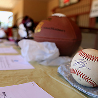 AARON STEWART || BUY AT PHOTOS.DJO<br /> <br /> A Jacob Lindergren autographed baseball sits at the silent auction table at the All-Star Football Camp benefiting the Boys and Girls Club Saturday Morning.