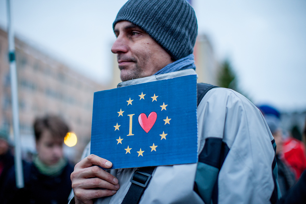 """Prostestor with a pro EU sign in front of  """"Top Hotel"""" in Prague's quater Chodov. They are protesting for European values and against the conference of the European anti-migrant parties """"Europe of Nations and Freedom"""" (ENF). Attending were Marie Le Pen from France, Geert Wilders from Holland and Tomio Okamura of the Freedom and Direct Democracy (SPD) movement from Czech Republic which was hosting the meeting."""