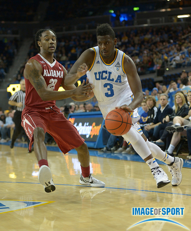 Dec 28, 2013; Los Angeles, CA, USA; UCLA Bruins guard Jordan Adams (3) is defended by Alabama Crimson Tide guard Levi Randolph (20) at Pauley Pavilion.